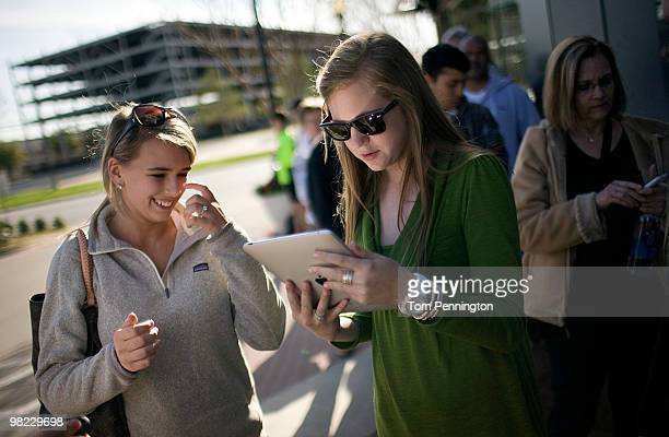 Shannon Bradshay and Macy Clayton react to handling the new iPad for the first time while waiting in line at the Apple Store April 3 2010 in Fort...