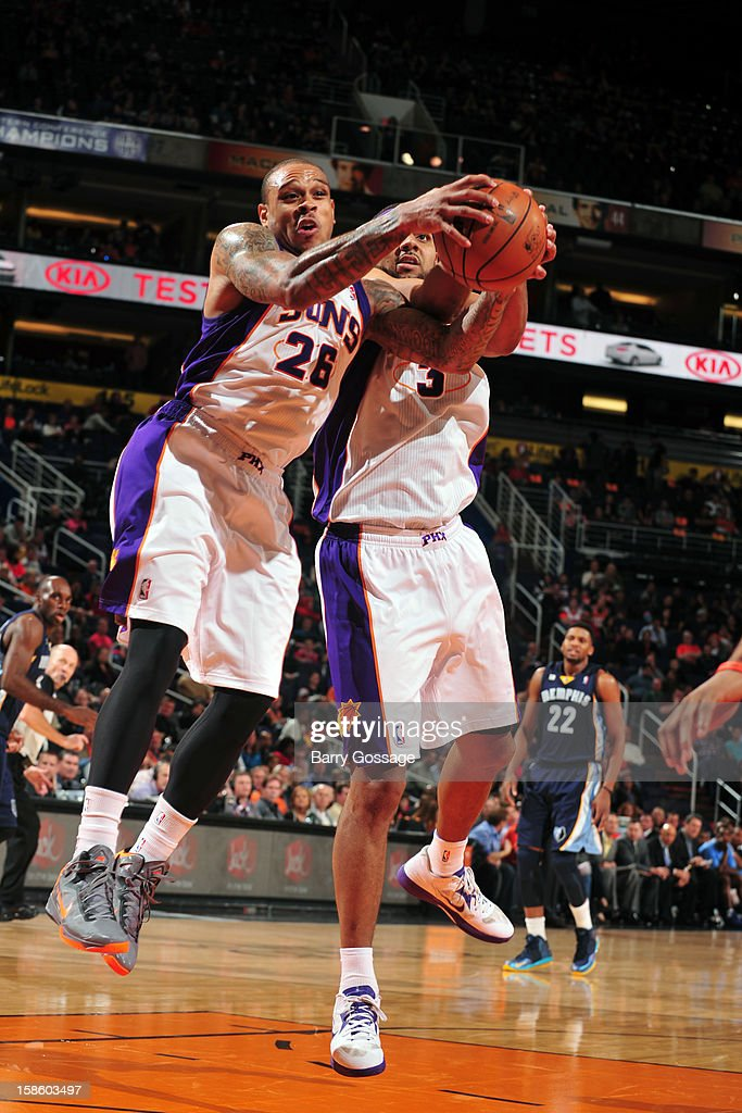 Shannon Brown #26 and <a gi-track='captionPersonalityLinkClicked' href=/galleries/search?phrase=Jared+Dudley&family=editorial&specificpeople=224071 ng-click='$event.stopPropagation()'>Jared Dudley</a> #3 of the Phoenix Suns fight for a rebound against the Memphis Grizzlies on December 12, 2012 at U.S. Airways Center in Phoenix, Arizona.