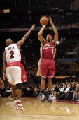 Shannon Brown of the Cleveland Cavaliers shoots a jump shot over Darrick Martin of the Toronto Raptors during a preseason game at the Air Canada...