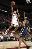 Shannon Brown of the Cleveland Cavaliers takes one to the basket over David Harrison of the Indiana Pacers December 09 2006 at The Quicken Loans...