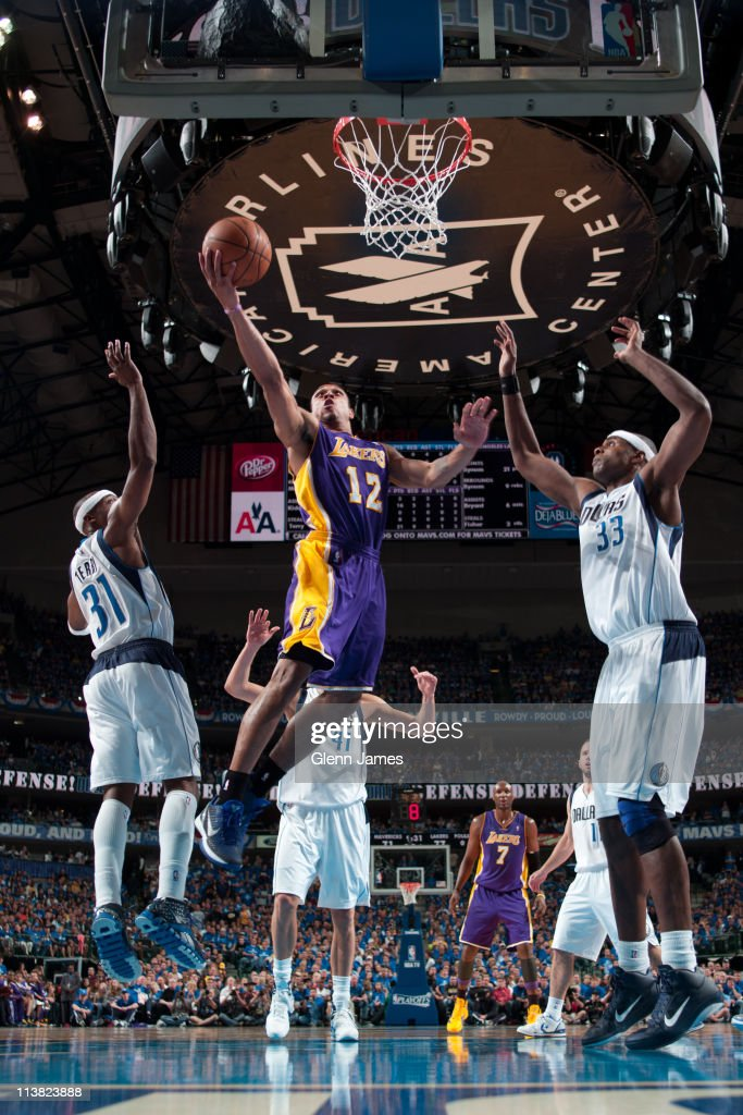 Shannon Brown #12 of the Los Angeles Lakers shoots against <a gi-track='captionPersonalityLinkClicked' href=/galleries/search?phrase=Jason+Terry&family=editorial&specificpeople=201734 ng-click='$event.stopPropagation()'>Jason Terry</a> #31 and <a gi-track='captionPersonalityLinkClicked' href=/galleries/search?phrase=Brendan+Haywood&family=editorial&specificpeople=202010 ng-click='$event.stopPropagation()'>Brendan Haywood</a> #33 of the Dallas Mavericks during Game Three of the Western Conference Semifinals in the 2011 NBA Playoffs on May 6, 2011 at the American Airlines Center in Dallas, Texas.