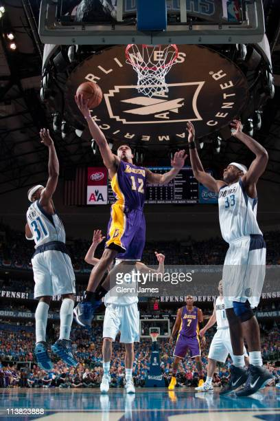 Shannon Brown of the Los Angeles Lakers shoots against Jason Terry and Brendan Haywood of the Dallas Mavericks during Game Three of the Western...