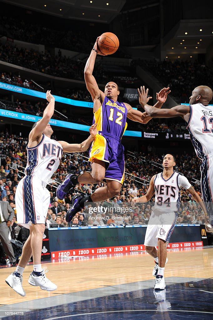 Shannon Brown #12 of the Los Angeles Lakers shoots against <a gi-track='captionPersonalityLinkClicked' href=/galleries/search?phrase=Jordan+Farmar&family=editorial&specificpeople=228137 ng-click='$event.stopPropagation()'>Jordan Farmar</a> #2 and <a gi-track='captionPersonalityLinkClicked' href=/galleries/search?phrase=Quinton+Ross&family=editorial&specificpeople=202478 ng-click='$event.stopPropagation()'>Quinton Ross</a> #13 of the New Jersey Nets on December 12, 2010 at the Prudential Center in Newark, New Jersey.