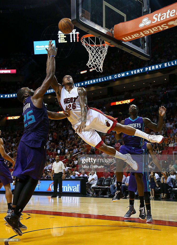 <a gi-track='captionPersonalityLinkClicked' href=/galleries/search?phrase=Shannon+Brown+-+Basketball+Player&family=editorial&specificpeople=7934998 ng-click='$event.stopPropagation()'>Shannon Brown</a> #26 of the Miami Heat drives on <a gi-track='captionPersonalityLinkClicked' href=/galleries/search?phrase=Al+Jefferson&family=editorial&specificpeople=201604 ng-click='$event.stopPropagation()'>Al Jefferson</a> #25 of the Charlotte Hornets during a game at American Airlines Arena on November 23, 2014 in Miami, Florida.