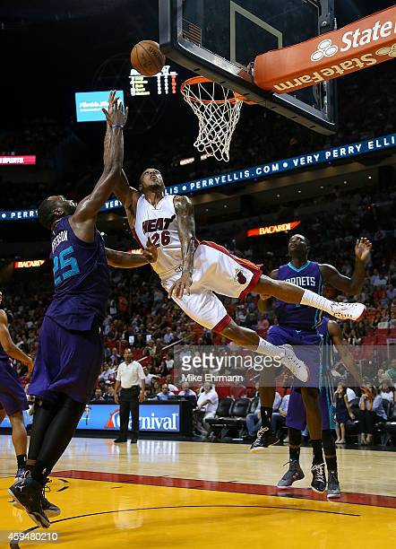 Shannon Brown of the Miami Heat drives on Al Jefferson of the Charlotte Hornets during a game at American Airlines Arena on November 23 2014 in Miami...