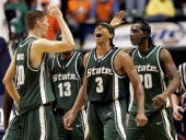Shannon Brown of the Michigan State Spartans yells as Paul Davis and Matt Trannon give each other a high five in the second half against the Illinois...