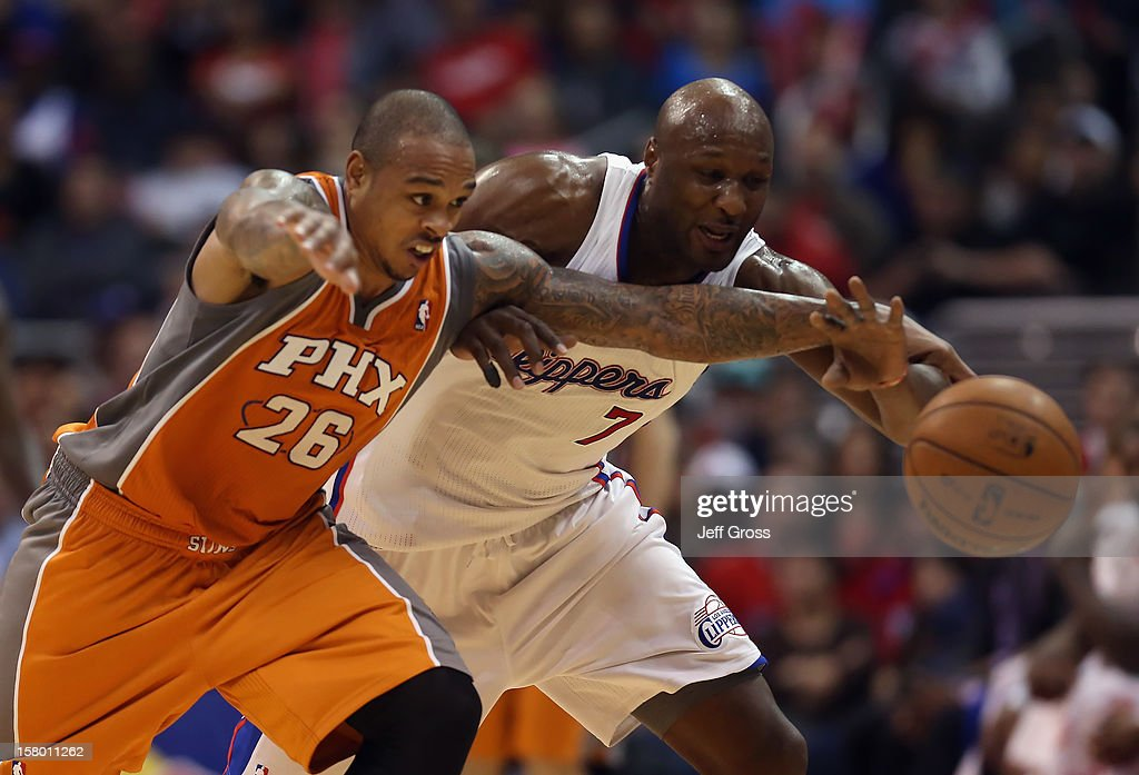 Shannon Brown #26 of the Phoenix Suns and Lamar Odom #7 of the Los Angeles Clippers fight for a loose ball in the second half at Staples Center on December 8, 2012 in Los Angeles, California. The Clippers defeated the Suns 117-99.