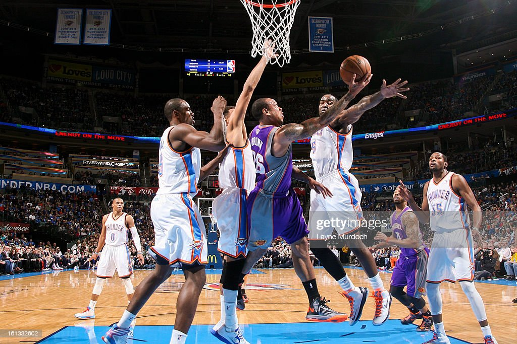 Shannon Brown #26 of the Phoenix Suns attempts a reverse layup against Kendrick Perkins #5, Serge Ibaka #9 and Thabo Sefolosha #2 of the Oklahoma City Thunder on February 8, 2013 at the Chesapeake Energy Arena in Oklahoma City, Oklahoma.