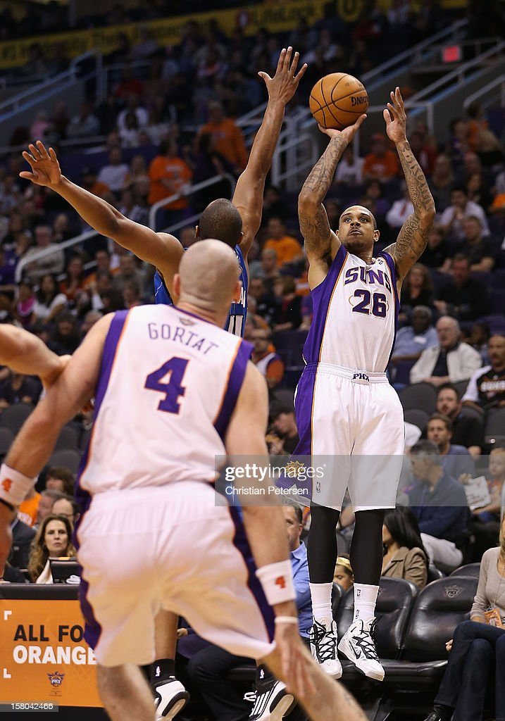 Shannon Brown #26 of the Phoenix Suns attempts a shot over <a gi-track='captionPersonalityLinkClicked' href=/galleries/search?phrase=Arron+Afflalo&family=editorial&specificpeople=640861 ng-click='$event.stopPropagation()'>Arron Afflalo</a> #4 of the Orlando Magic during the NBA game at US Airways Center on December 9, 2012 in Phoenix, Arizona. The Magic defeated the Suns 98-90.