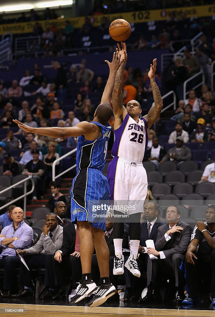 Shannon Brown #26 of the Phoenix Suns attempts a shot over Arron Afflalo #4 of the Orlando Magic during the NBA game at US Airways Center on December 9, 2012 in Phoenix, Arizona. The Magic defeated the Suns 98-90.