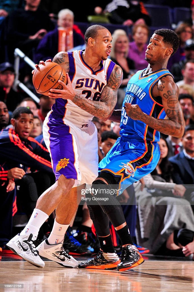 Shannon Brown #26 of the Phoenix Suns controls the ball against <a gi-track='captionPersonalityLinkClicked' href=/galleries/search?phrase=DeAndre+Liggins&family=editorial&specificpeople=5590638 ng-click='$event.stopPropagation()'>DeAndre Liggins</a> #25 of the Oklahoma City Thunder on January 14, 2013 at U.S. Airways Center in Phoenix, Arizona.