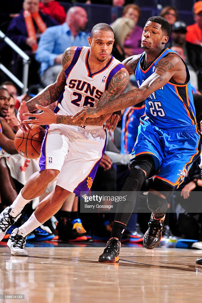 Shannon Brown #26 of the Phoenix Suns drives against <a gi-track='captionPersonalityLinkClicked' href=/galleries/search?phrase=DeAndre+Liggins&family=editorial&specificpeople=5590638 ng-click='$event.stopPropagation()'>DeAndre Liggins</a> #25 of the Oklahoma City Thunder on January 14, 2013 at U.S. Airways Center in Phoenix, Arizona.