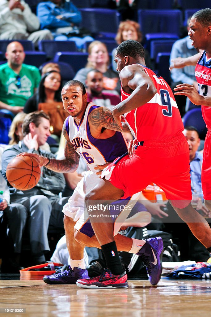 Shannon Brown #26 of the Phoenix Suns drives against <a gi-track='captionPersonalityLinkClicked' href=/galleries/search?phrase=Martell+Webster&family=editorial&specificpeople=601785 ng-click='$event.stopPropagation()'>Martell Webster</a> #9 of the Washington Wizards on March 20, 2013 at U.S. Airways Center in Phoenix, Arizona.