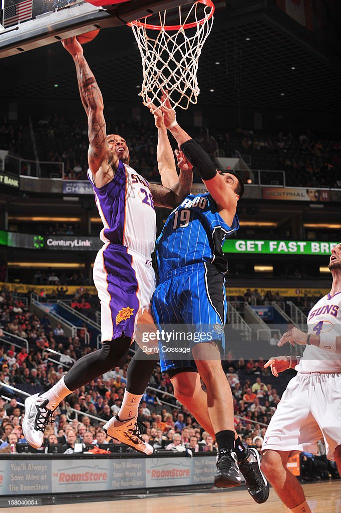 Shannon Brown #26 of the Phoenix Suns drives for a shot against Gustavo Ayon #19 of the Orlando Magic on December 9, 2012 at U.S. Airways Center in Phoenix, Arizona.