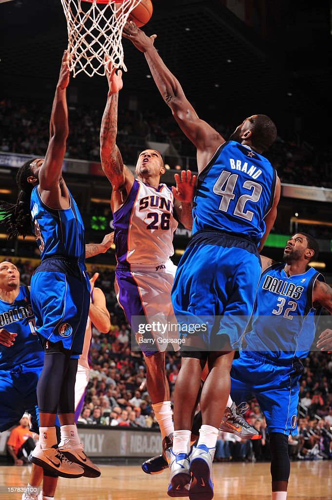 Shannon Brown #26 of the Phoenix Suns drives for a shot between Jae Crowder #9 and Elton Brand #42 of the Dallas Mavericks on December 6, 2012 at U.S. Airways Center in Phoenix, Arizona.