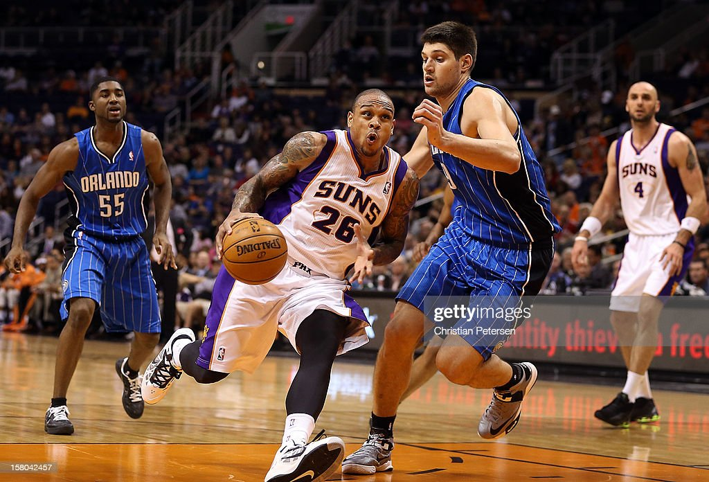 Shannon Brown #26 of the Phoenix Suns drives the ball past Nikola Vucevic #9 of the Orlando Magic during the NBA game at US Airways Center on December 9, 2012 in Phoenix, Arizona. The Magic defeated the Suns 98-90.