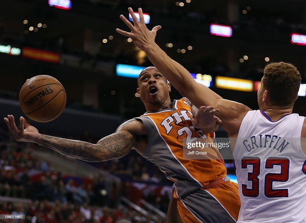 Shannon Brown of the Phoenix Suns drives to the basket, while defended by Blake Griffin #32 of the Los Angeles Clippers in the first half at Staples Center on December 8, 2012 in Los Angeles, California. The Clippers defeated the Suns 117-99.