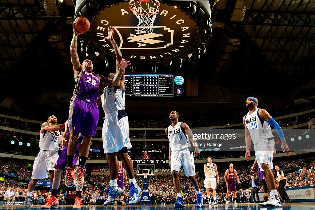 Shannon Brown #26 of the Phoenix Suns goes to the basket against <a gi-track='captionPersonalityLinkClicked' href=/galleries/search?phrase=Elton+Brand&family=editorial&specificpeople=201501 ng-click='$event.stopPropagation()'>Elton Brand</a> #42 of the Dallas Mavericks on January 27, 2013 at the American Airlines Center in Dallas, Texas.