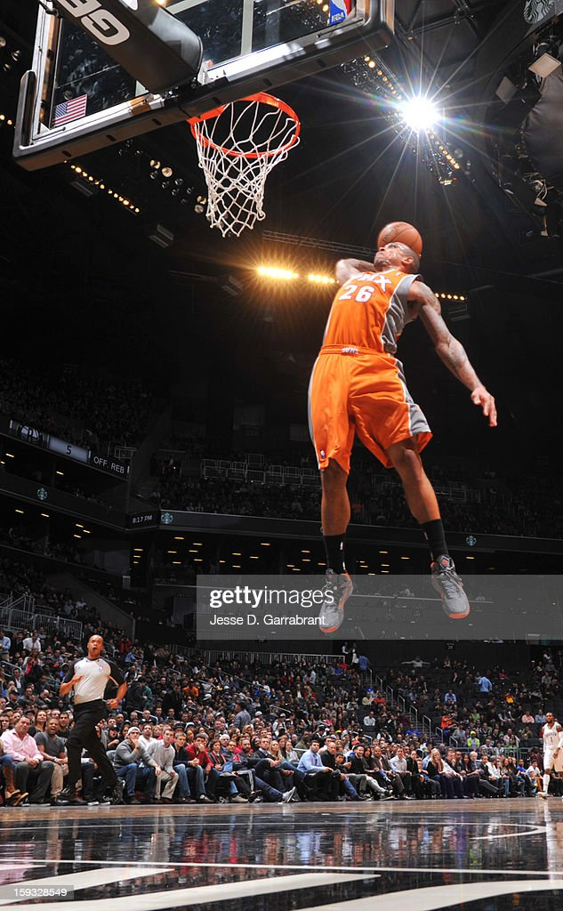 Shannon Brown #26 of the Phoenix Suns goes up for the slam dunk against the Brooklyn Nets during the game at the Barclays Center on January 11, 2013 in Brooklyn, New York.