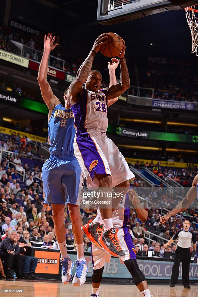 Shannon Brown #26 of the Phoenix Suns grabs a rebound against against the Denver Nuggets on March 11, 2013 at U.S. Airways Center in Phoenix, Arizona.