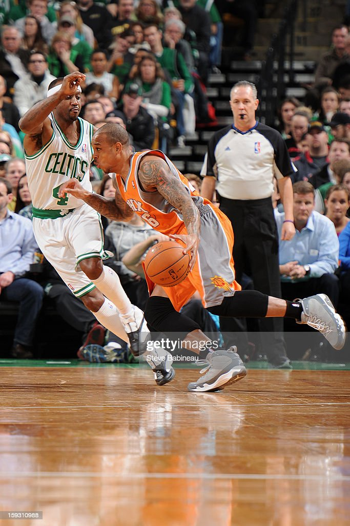 Shannon Brown #26 of the Phoenix Suns handles the ball against <a gi-track='captionPersonalityLinkClicked' href=/galleries/search?phrase=Jason+Terry&family=editorial&specificpeople=201734 ng-click='$event.stopPropagation()'>Jason Terry</a> #4 of the Boston Celtics on January 9, 2013 at the TD Garden in Boston, Massachusetts.