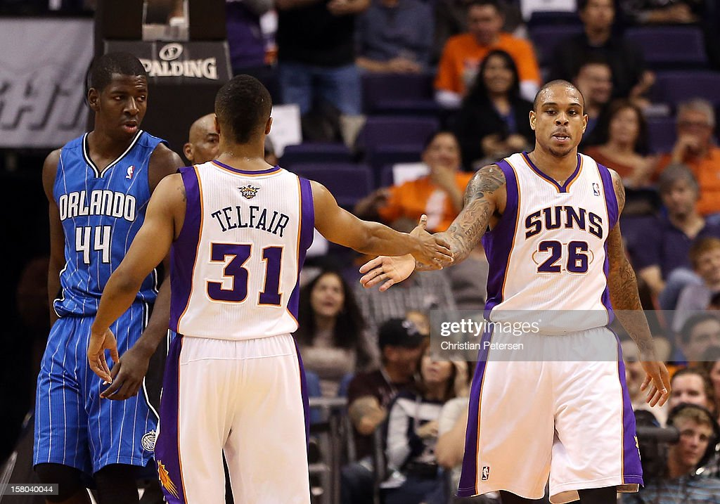 Shannon Brown #26 of the Phoenix Suns high-fives Sebastian Telfair #31 after scoring against the Orlando Magic during the NBA game at US Airways Center on December 9, 2012 in Phoenix, Arizona.
