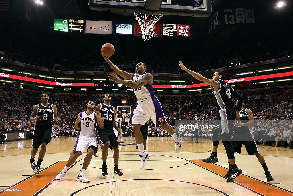 Shannon Brown #26 of the Phoenix Suns lays up a shot against the San Antonio Spurs during the NBA game at US Airways Center on April 25, 2012 in Phoenix, Arizona.