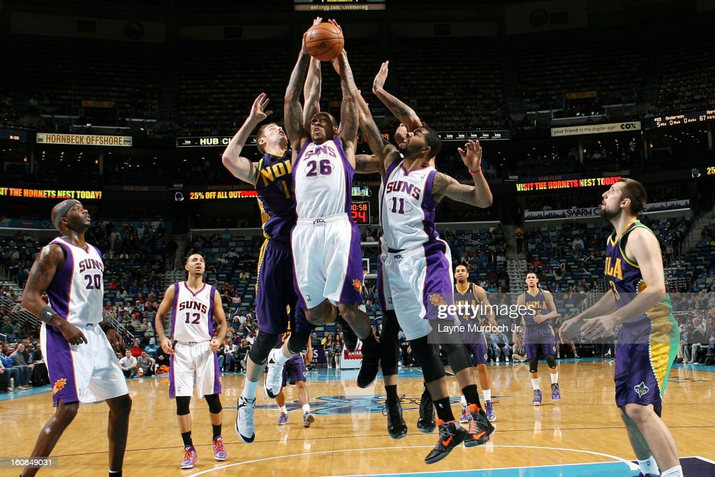 Shannon Brown #26 of the Phoenix Suns pulls down a rebound against Jason Smith #14 of the New Orleans Hornets on February 06, 2013 at the New Orleans Arena in New Orleans, Louisiana.