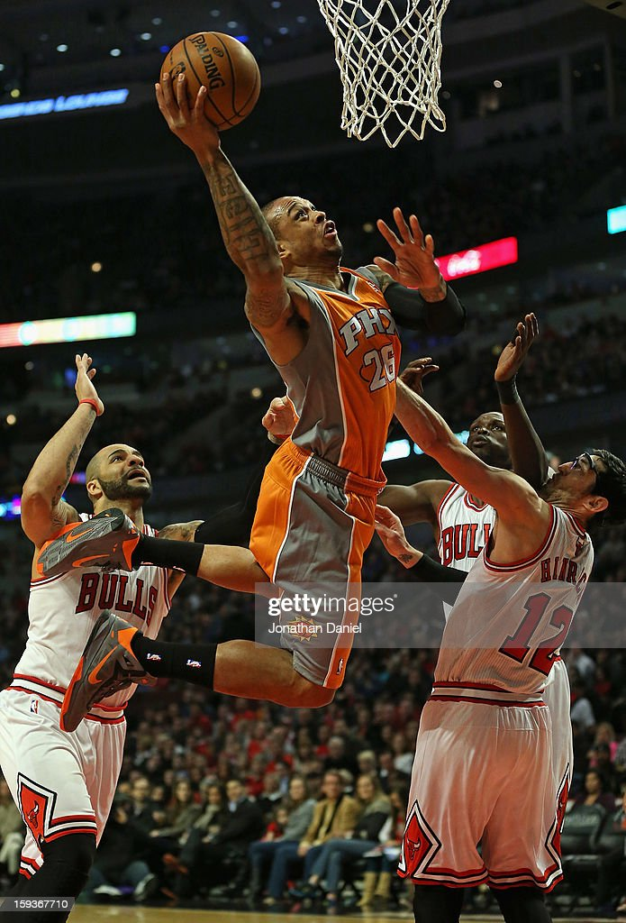 Shannon Brown #26 of the Phoenix Suns puts up a shot over (L-R) <a gi-track='captionPersonalityLinkClicked' href=/galleries/search?phrase=Carlos+Boozer&family=editorial&specificpeople=201638 ng-click='$event.stopPropagation()'>Carlos Boozer</a> #5, Loul Deng #9 and <a gi-track='captionPersonalityLinkClicked' href=/galleries/search?phrase=Kirk+Hinrich&family=editorial&specificpeople=201629 ng-click='$event.stopPropagation()'>Kirk Hinrich</a> #12 of the Chicago Bulls at the United Center on January 12, 2013 in Chicago, Illinois.