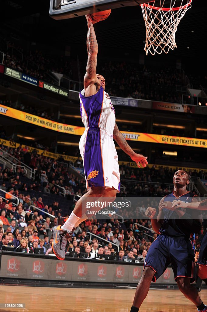 Shannon Brown #26 of the Phoenix Suns rises for a dunk against <a gi-track='captionPersonalityLinkClicked' href=/galleries/search?phrase=Bismack+Biyombo&family=editorial&specificpeople=7640443 ng-click='$event.stopPropagation()'>Bismack Biyombo</a> #0 of the Charlotte Bobcats on December 19, 2012 at U.S. Airways Center in Phoenix, Arizona.