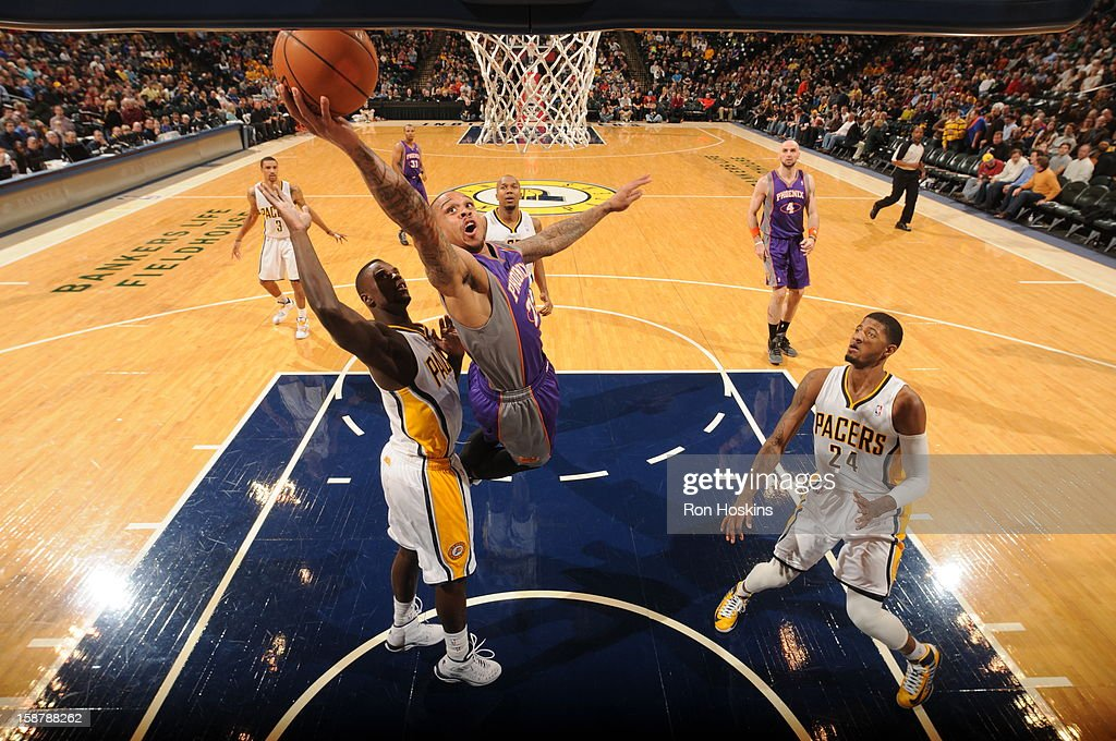 <a gi-track='captionPersonalityLinkClicked' href=/galleries/search?phrase=Shannon+Brown+-+Basketballer&family=editorial&specificpeople=7934998 ng-click='$event.stopPropagation()'>Shannon Brown</a> #26 of the Phoenix Suns shoots a layup against <a gi-track='captionPersonalityLinkClicked' href=/galleries/search?phrase=Lance+Stephenson&family=editorial&specificpeople=5298304 ng-click='$event.stopPropagation()'>Lance Stephenson</a> #1 of the Indiana Pacers' on December 28, 2012 at Bankers Life Fieldhouse in Indianapolis, Indiana.