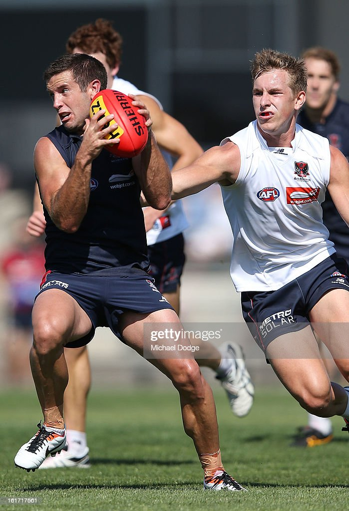 Shannon Byrnes runs with the ball during a Melbourne Demons intra-club match session at Casey Fields on February 15, 2013 in Melbourne, Australia.