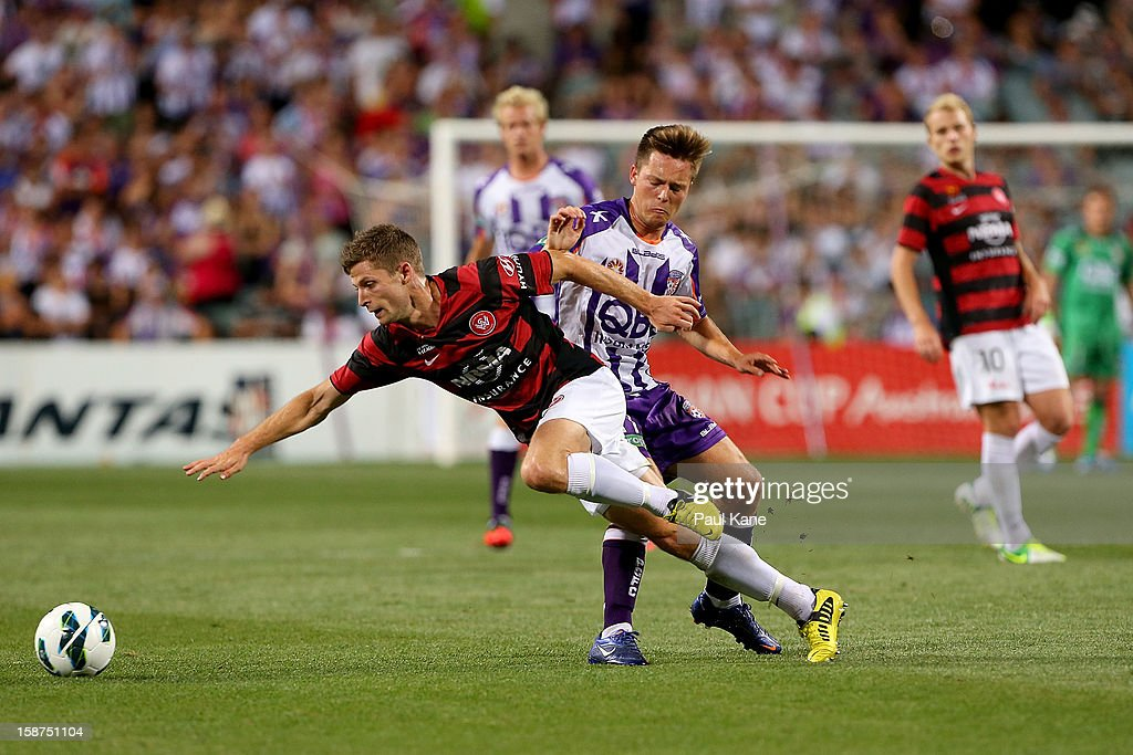 Shannon Cole of the Wanderers and Chris Harold of the Glory contest for the ball during the round 13 A-League match between the Perth Glory and the Western Sydney Wanderers at Patersons Stadium on December 27, 2012 in Perth, Australia.