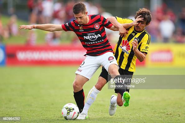 Shannon Cole of the Wanderers competes with Albert Riera of the Phoenix during the round 16 ALeague match between the Western Sydney Wanderers and...