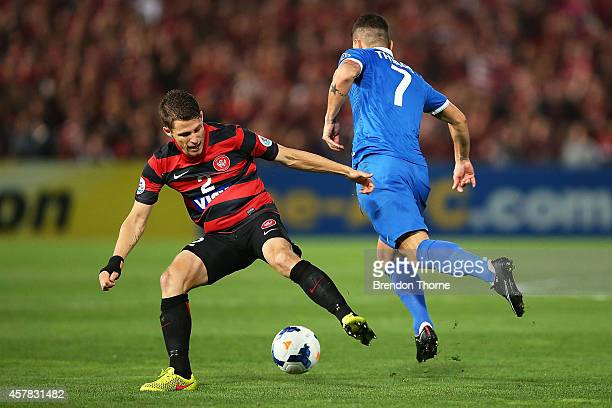 Shannon Cole of the Wanderers competes with Thiago Neves of AlHilal during the Asian Champions League final match between the Western Sydney...