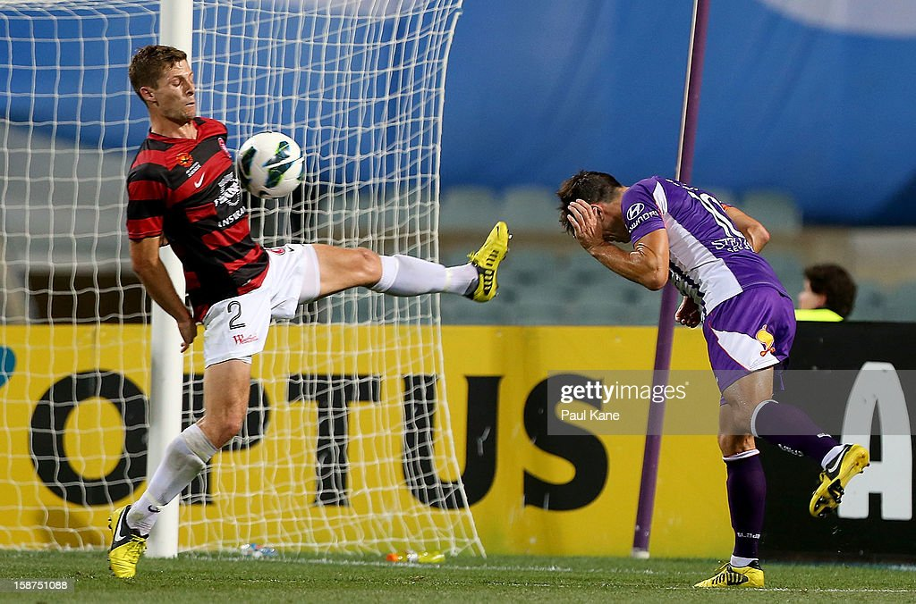 Shannon Cole of the Wanderers saves a shot on goal by <a gi-track='captionPersonalityLinkClicked' href=/galleries/search?phrase=Liam+Miller&family=editorial&specificpeople=212726 ng-click='$event.stopPropagation()'>Liam Miller</a> of the Glory during the round 13 A-League match between the Perth Glory and the Western Sydney Wanderers at Patersons Stadium on December 27, 2012 in Perth, Australia.