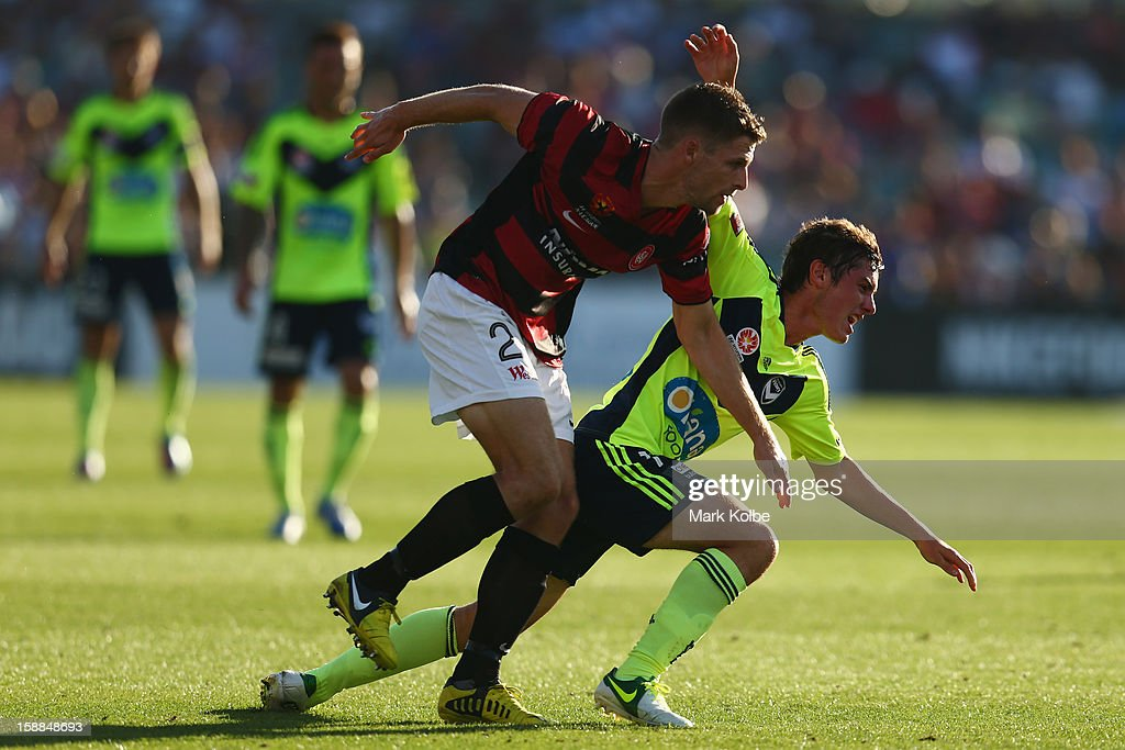 Shannon Cole of the Wanderers tackles Marco Rojas of the Victory during the round 14 A-League match between the Western Sydney Wanderers and the Melbourne Victory at Parramatta Stadium on January 1, 2013 in Sydney, Australia.
