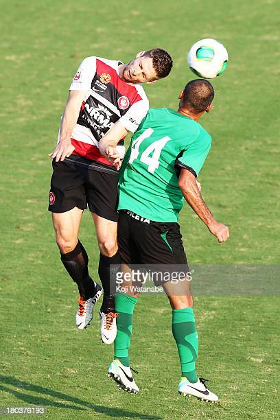 Shannon Cole of Western Sydney Wanderers and Naohiro Takahara of Tokyo Verdy compete for the ball during the match between Western Sydney Wanderers v...
