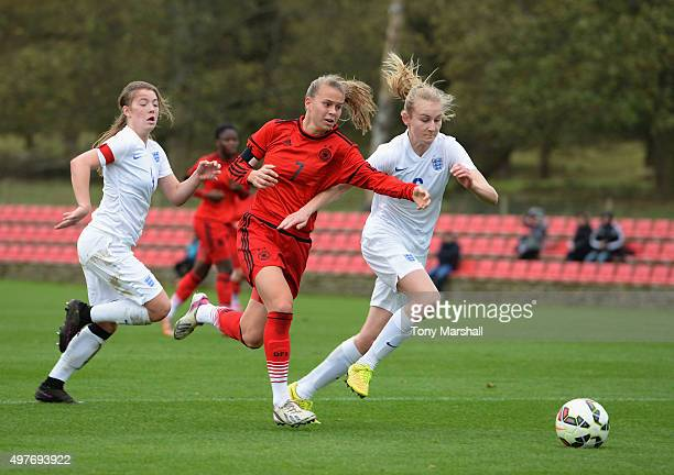 Shannon Cook of England holds off a challenge from Klara Buhl of Germany during Women's U16s International Friendly match between England U16s Women...