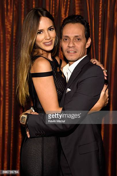 Shannon De Lima and Marc Anthony pose backstage at Radio City Music Hall on August 27 2016 in New York City