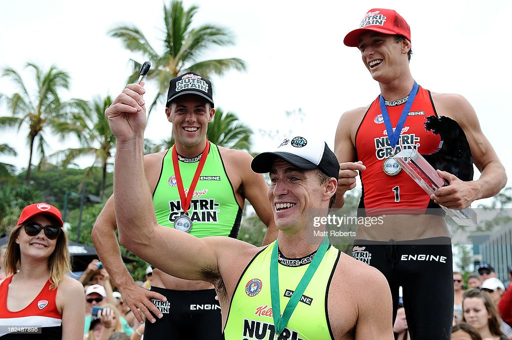 Shannon Eckstein (C) holds up the key to the series winners prize, a Ducati motorcycle after the Noosa Heads round of the 2012-13 Kelloggs Nutri-Grain Ironman Series on February 24, 2013 in Noosa, Australia.
