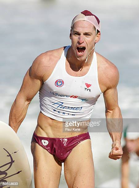 Shannon Eckstein of Northcliffe celebrates winning the Open Men's Board Race final during day six of the 2009 Australian Surf Lifesaving...