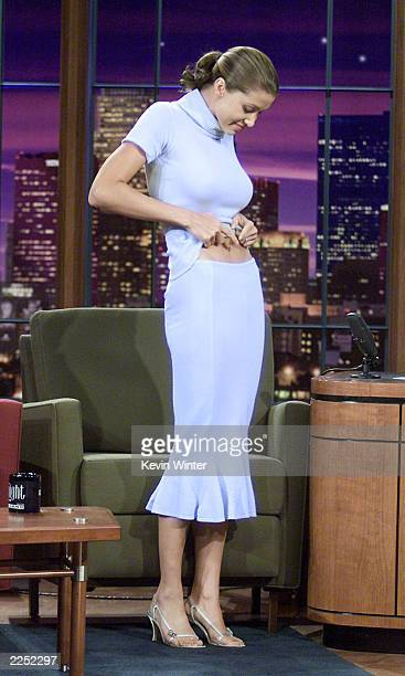 Shannon Elizabeth shows off her new diamondstudded bellybutton piercing at 'The Tonight Show with Jay Leno' at the NBC Studios in Burbank Ca 8/23/01...