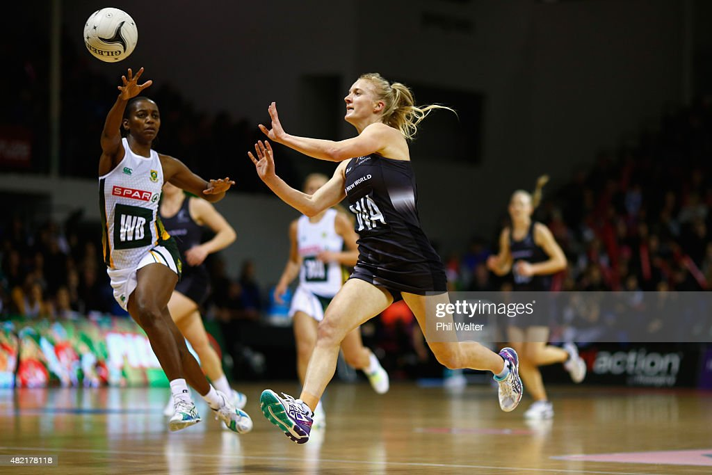 Shannon Francois of the Silver Ferns passes under pressure from Precious Niemand of the Proteas during the International Test Match between the New...