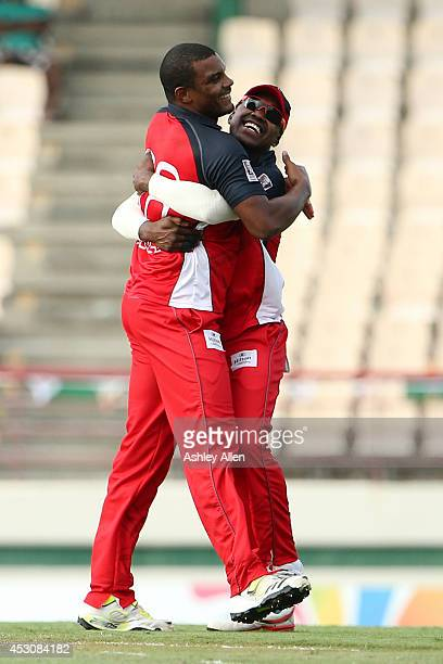 Shannon Gabriel and Darren Bravo of The Red Steel celebrate during a match between St Lucia Zouks and The Trinidad and Tobago Red Steel as part of...