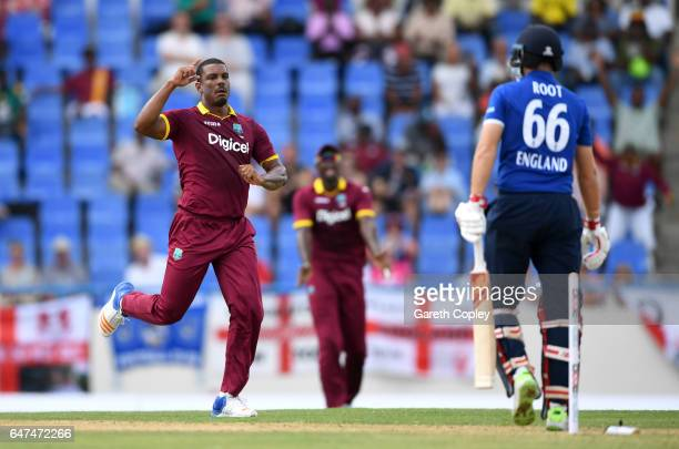 Shannon Gabriel of the West Indies celebrates dismissing Joe Root of England during the first One Day International between the West Indies and...