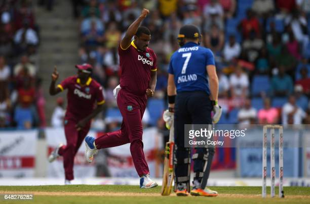 Shannon Gabriel of the West Indies celebrates dismissing Sam Billings of England during the 2nd One Day International match between the West Indies...