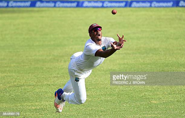 TOPSHOT Shannon Gabriel of the West Indies misses cathcing out India's Ajinkya Rahane shot off bowler Roston Chase on July 31 2016 at Sabina Park in...