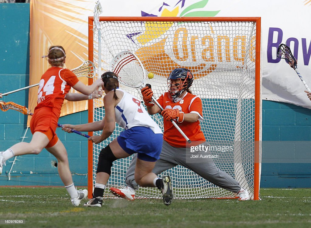 Shannon Gilroy #8 of the Florida Gators scores a goal past goalkeeper Alyssa Costantino #30 of the Syracuse Orange during the 2013 Orange Bowl Lacrosse Classic on March 2, 2013 at SunLife Stadium in Miami Gardens, Florida.