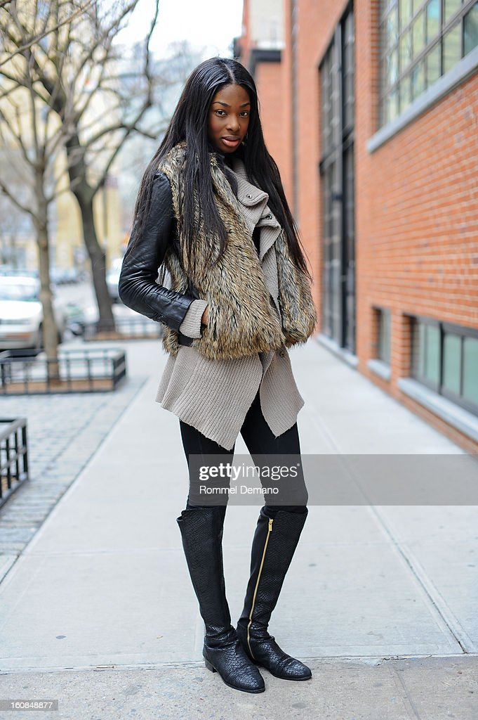 Shannon Hamilton from New York is seen outside the Micah Cohen show wearing vintage sweater, Victoria's Secret fur vest and Michael Kors shoes on February 6, 2013 in New York City.